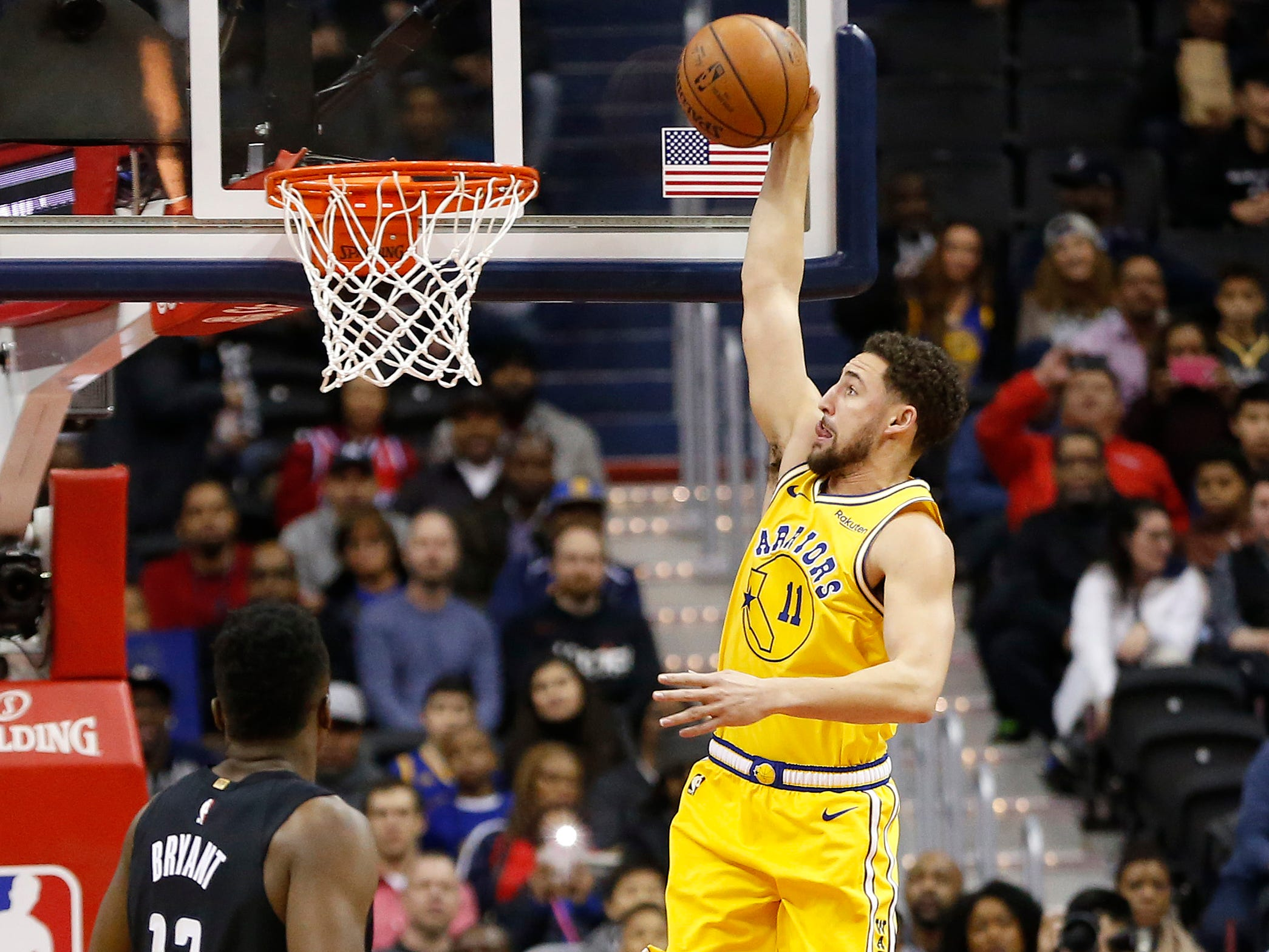 Jan. 24: Warriors guard Klay Thompson rises up for the one-handed flush during the first half against the Wizards in Washington.
