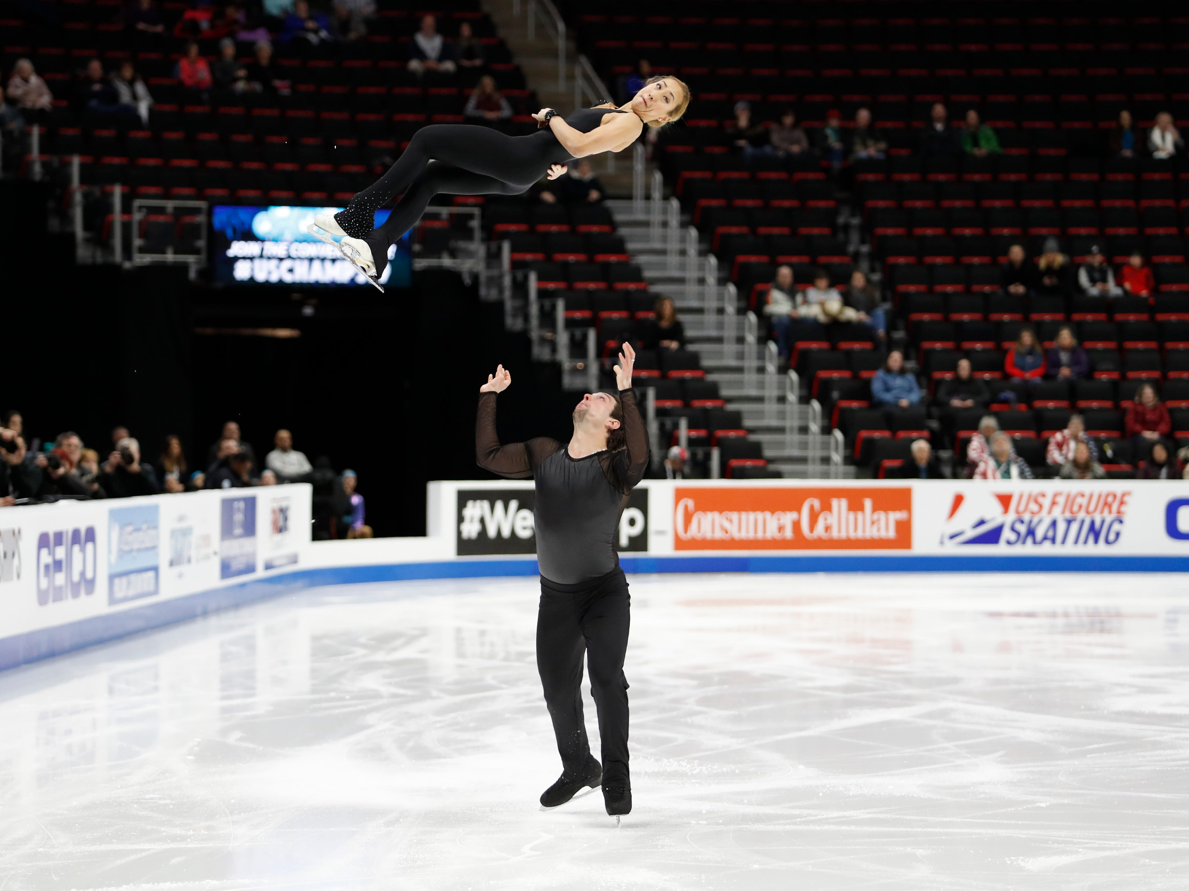 Erika Smith and A.J. Reiss perform in the pairs short program.