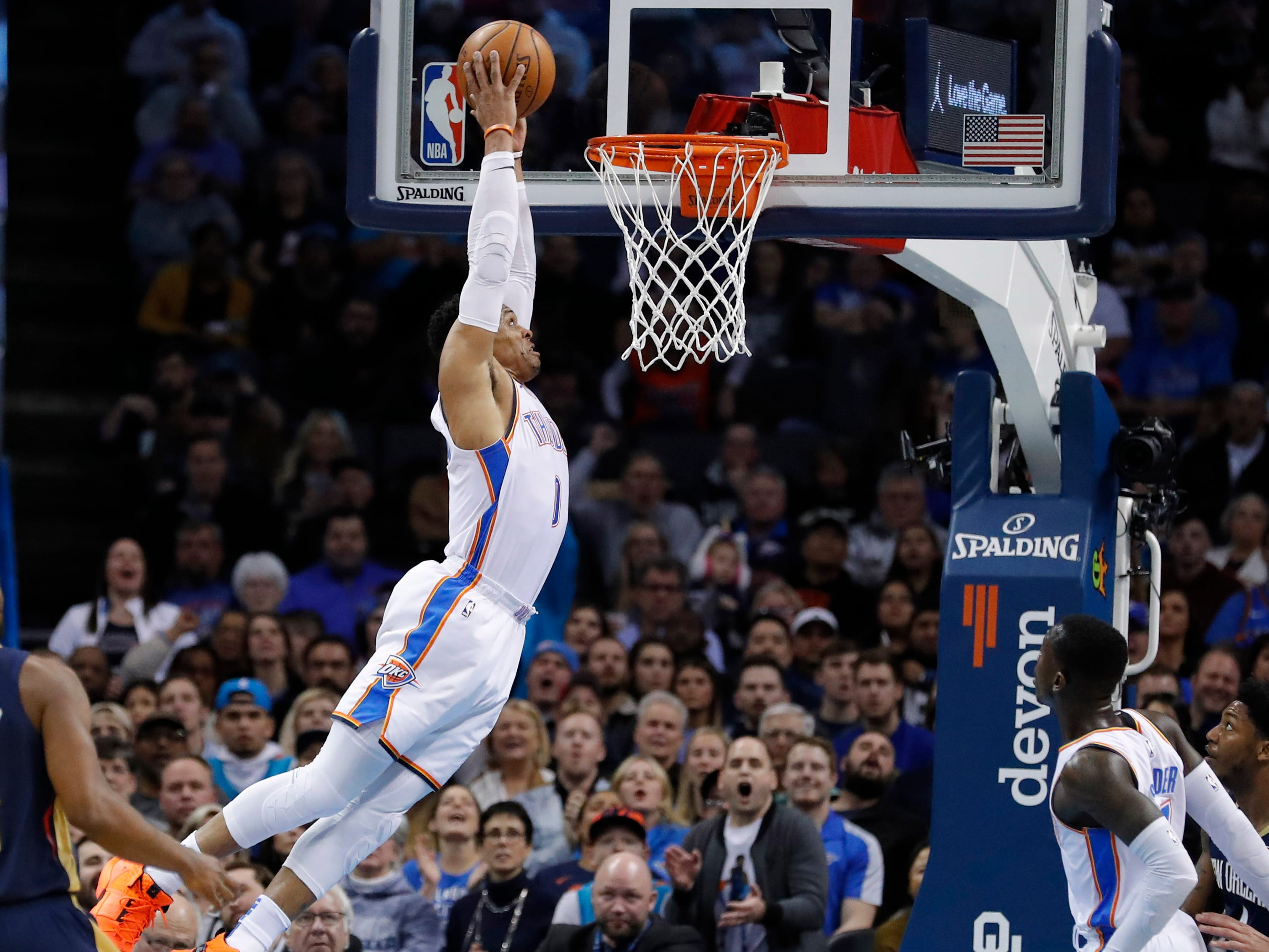 Jan. 24: Thunder guard Russell Westbrook soars to the bucket for the monster two-handed finish during the first half against the Pelicans in Oklahoma City.