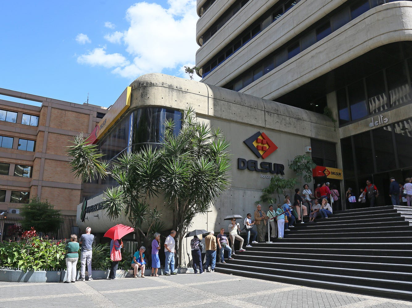 Retrired people wait in a line at Delsur Bank to get their pensions paid on Jan. 24, 2019 in Caracas, Venezuela.