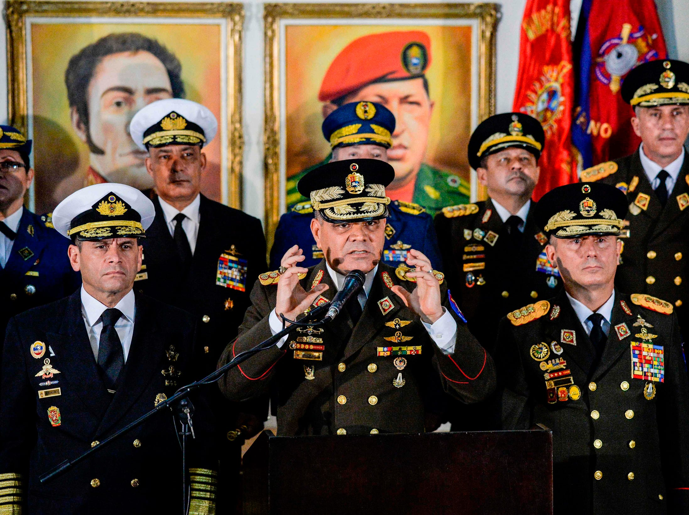 "Venezuelan Defense Minister Vladimir Padrino Lopez speaks, Thursday, along with members of the top military leadership in support of president Nicolas Maduro. Padrino Lopez accused opposition leader Juan Guaido of launching a ""coup d'etat"" by proclaiming himself acting president and said the military would show ""backing for the sovereignty"" of Venezuela."