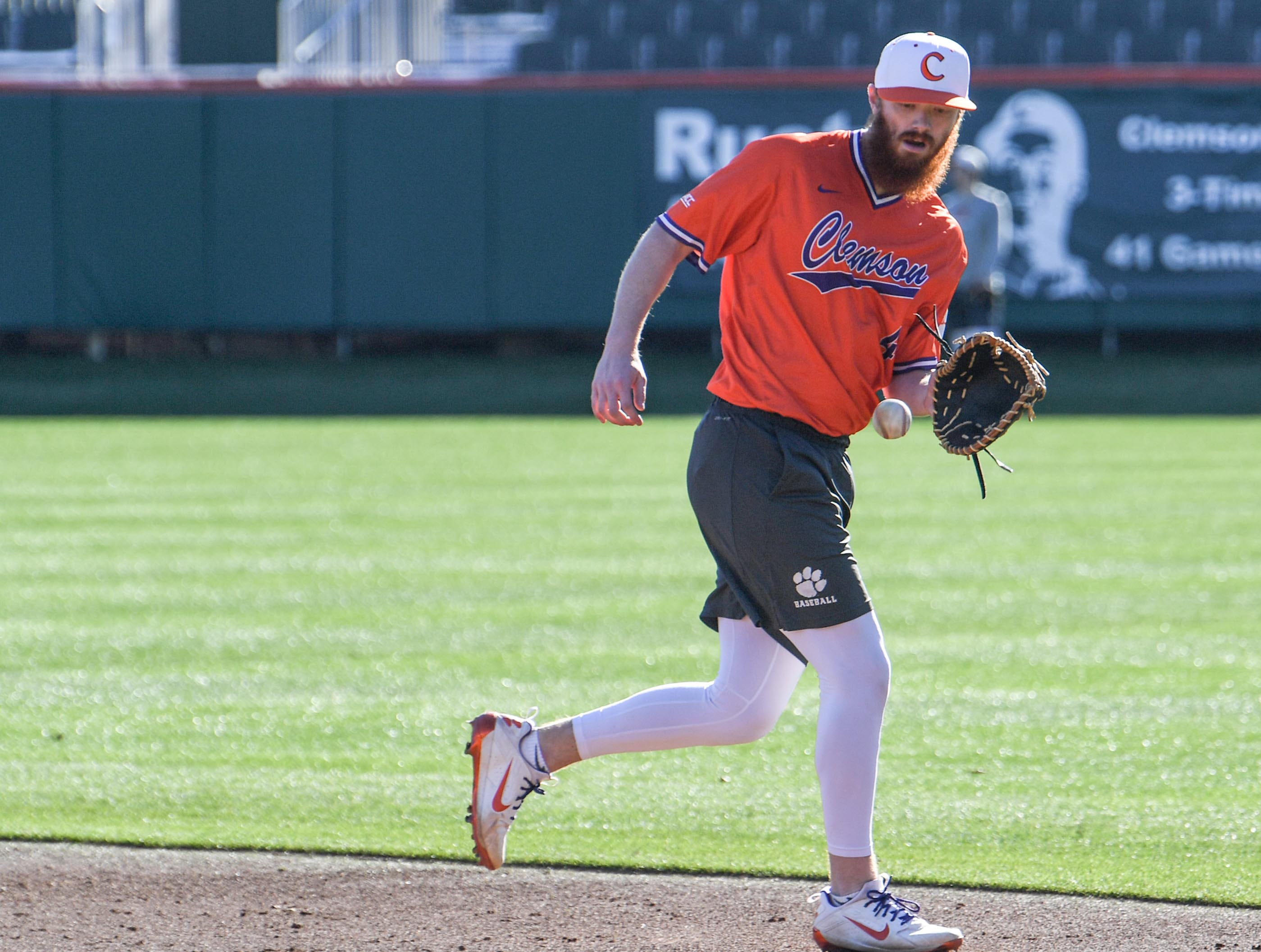 Clemson first baseman Grayson Byrd fields a ball to first base during practice at Doug Kingsmore Stadium in Clemson Friday.