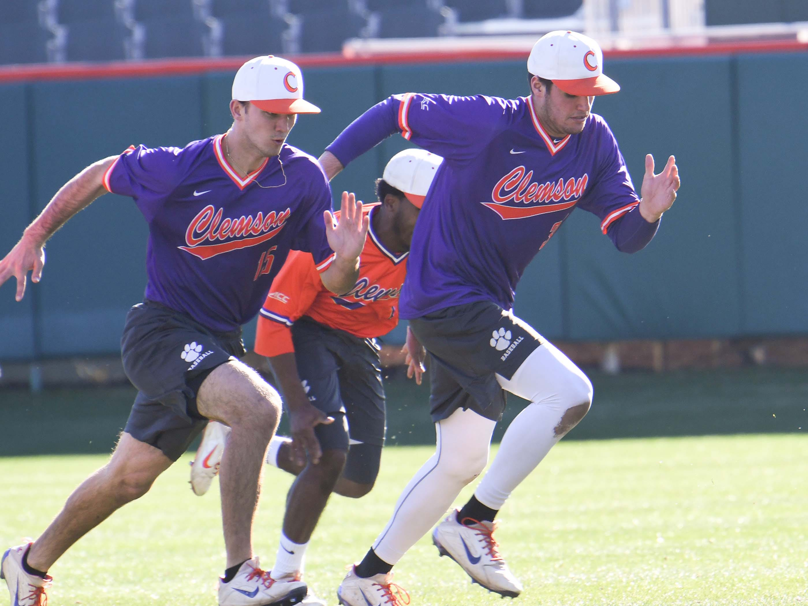 Clemson freshmen James Parker (15), left, and pitcher Davis Sharpe (30), warm up together during practice at Doug Kingsmore Stadium in Clemson Friday.