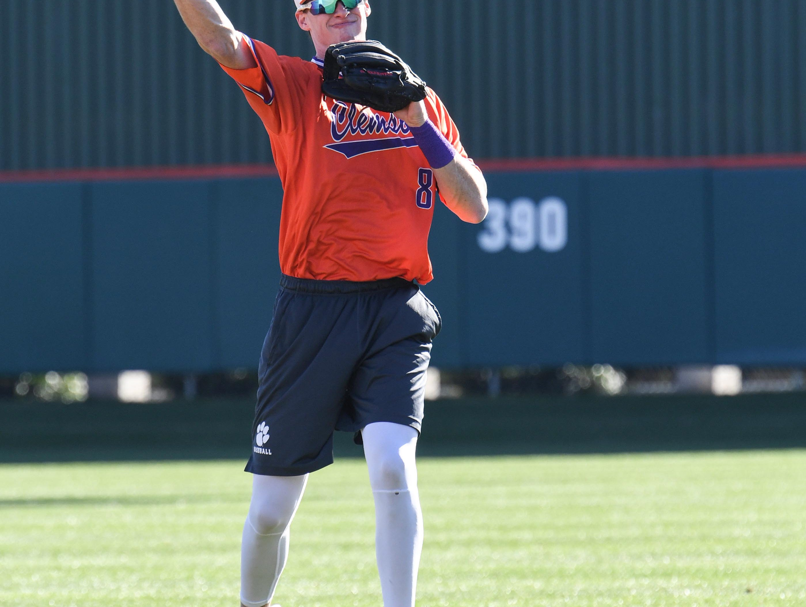 Clemson shortstop Logan Davidson (8) warms up with teammates during practice at Doug Kingsmore Stadium in Clemson Friday.