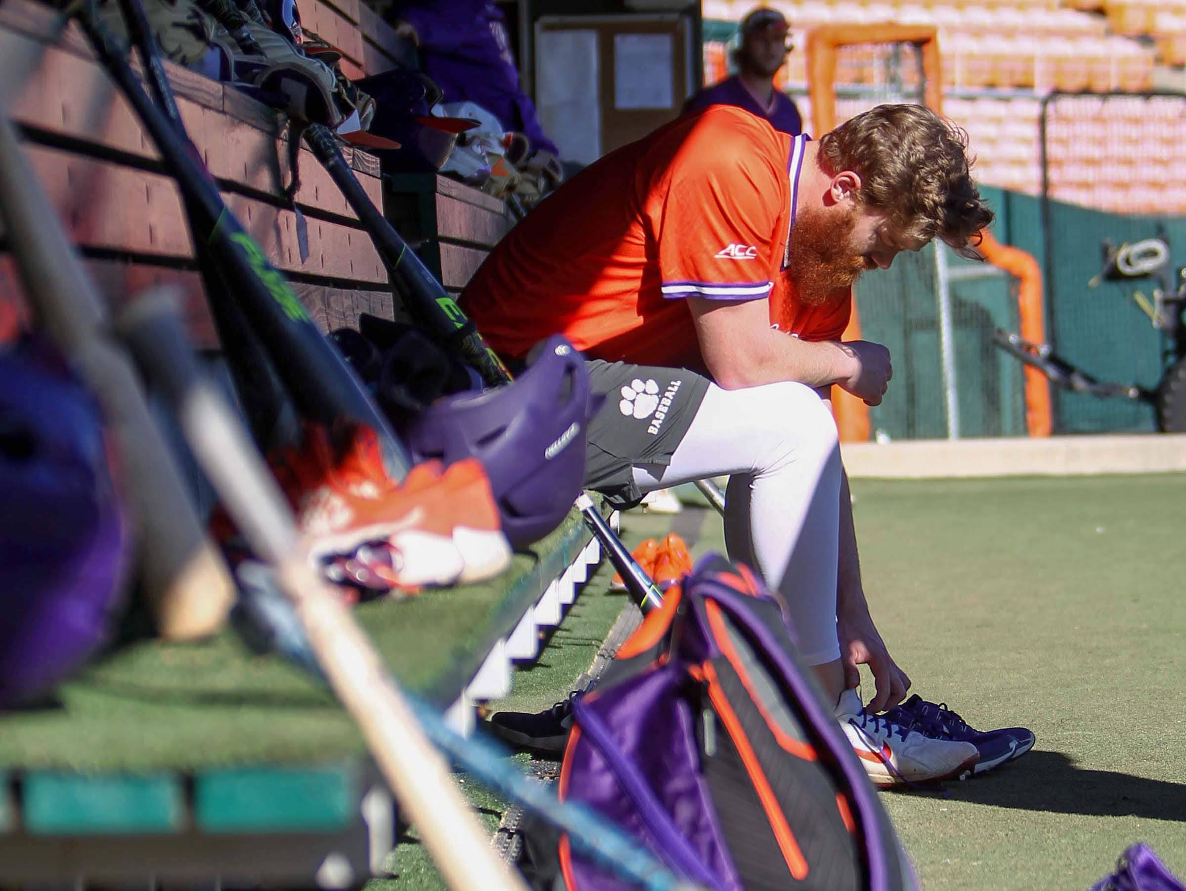 Clemson infielder Grayson Byrd gets ready in the dugout before practice at Doug Kingsmore Stadium in Clemson Friday.