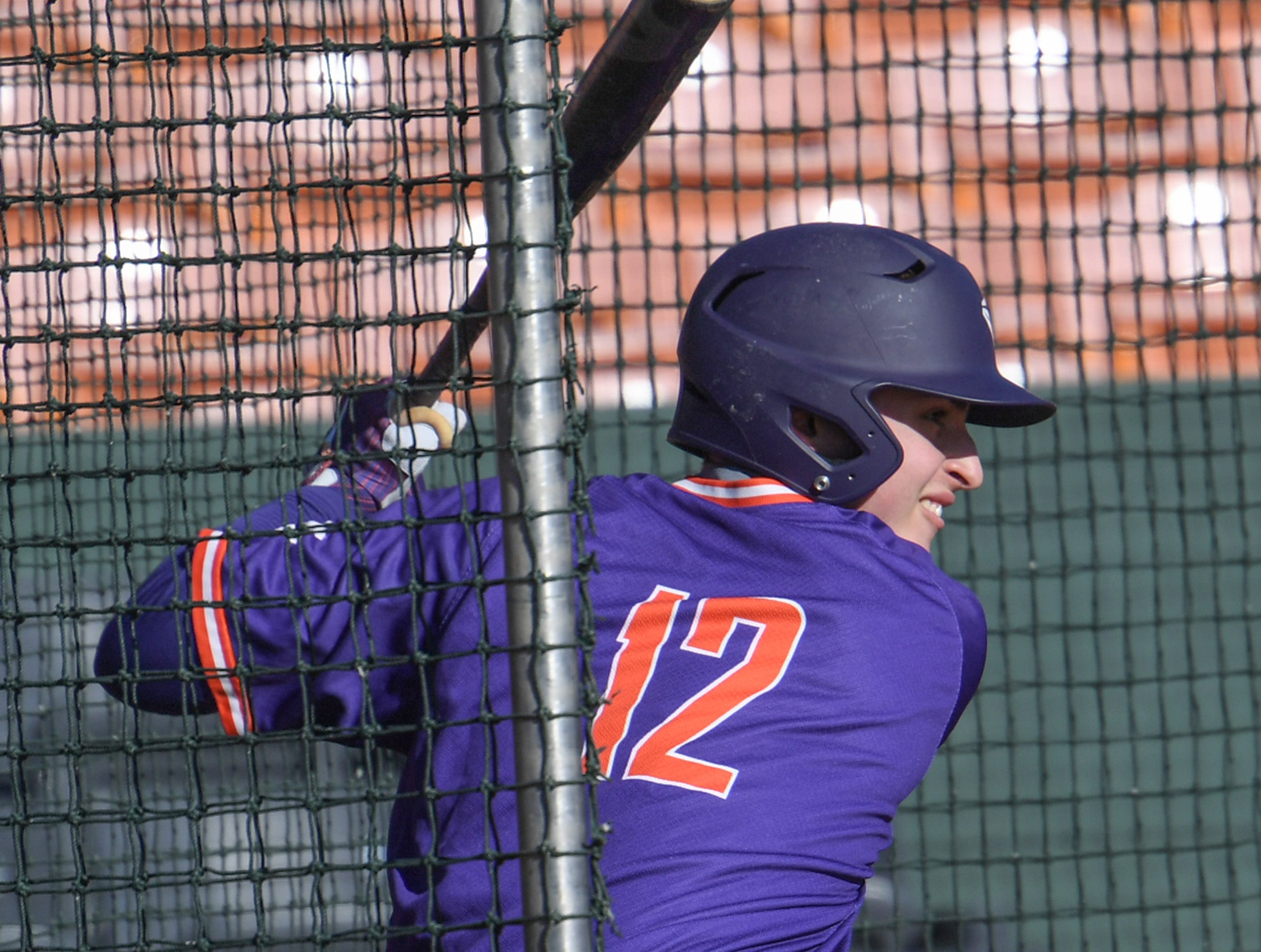 Clemson freshmen Justin Wrobleski (12) waits on a pitch during practice at Doug Kingsmore Stadium in Clemson Friday.