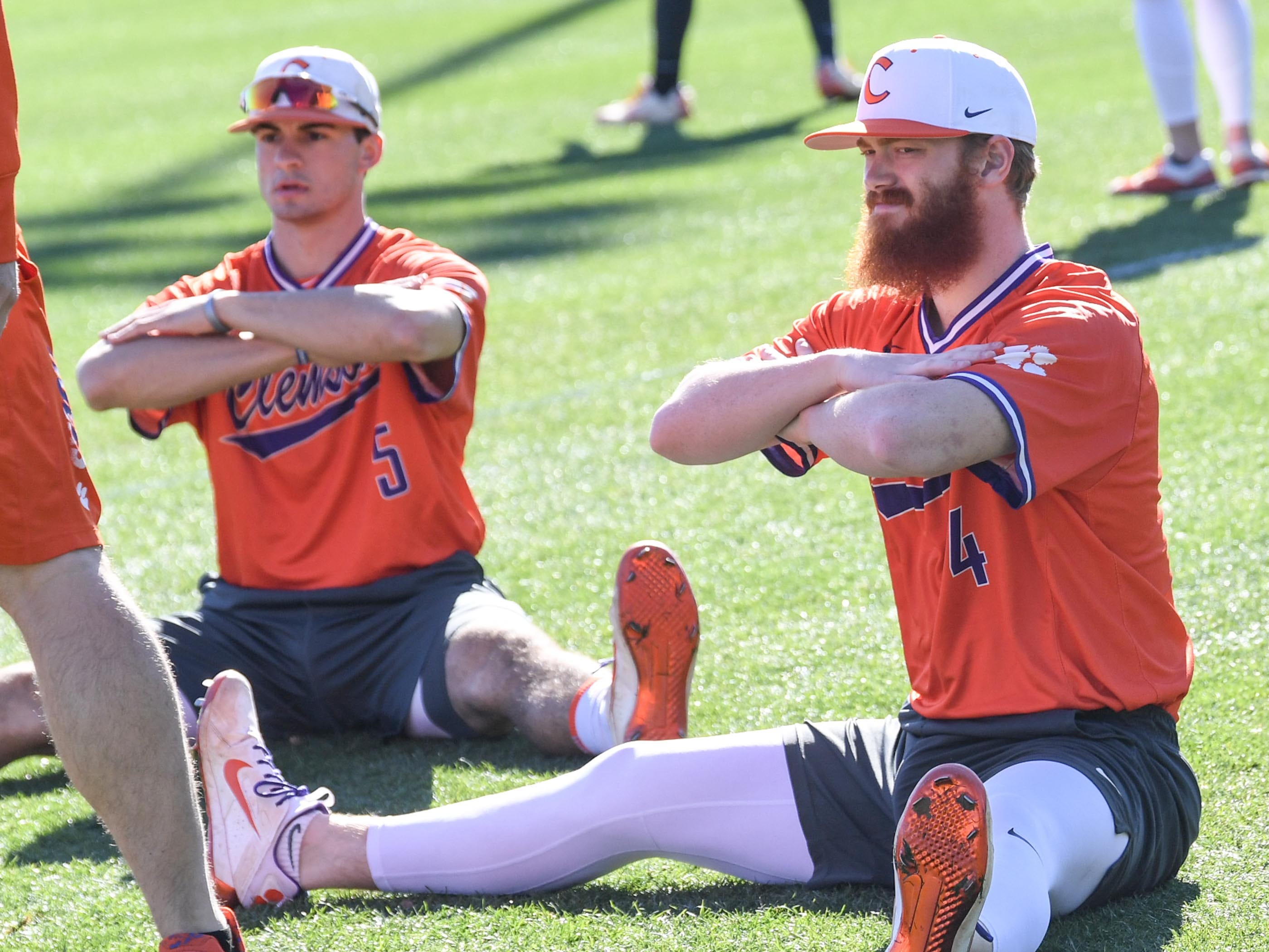 Clemson freshman Sam Hall, left, and redshirt sophomore Grayson Byrd stretch during practice at Doug Kingsmore Stadium in Clemson Friday.