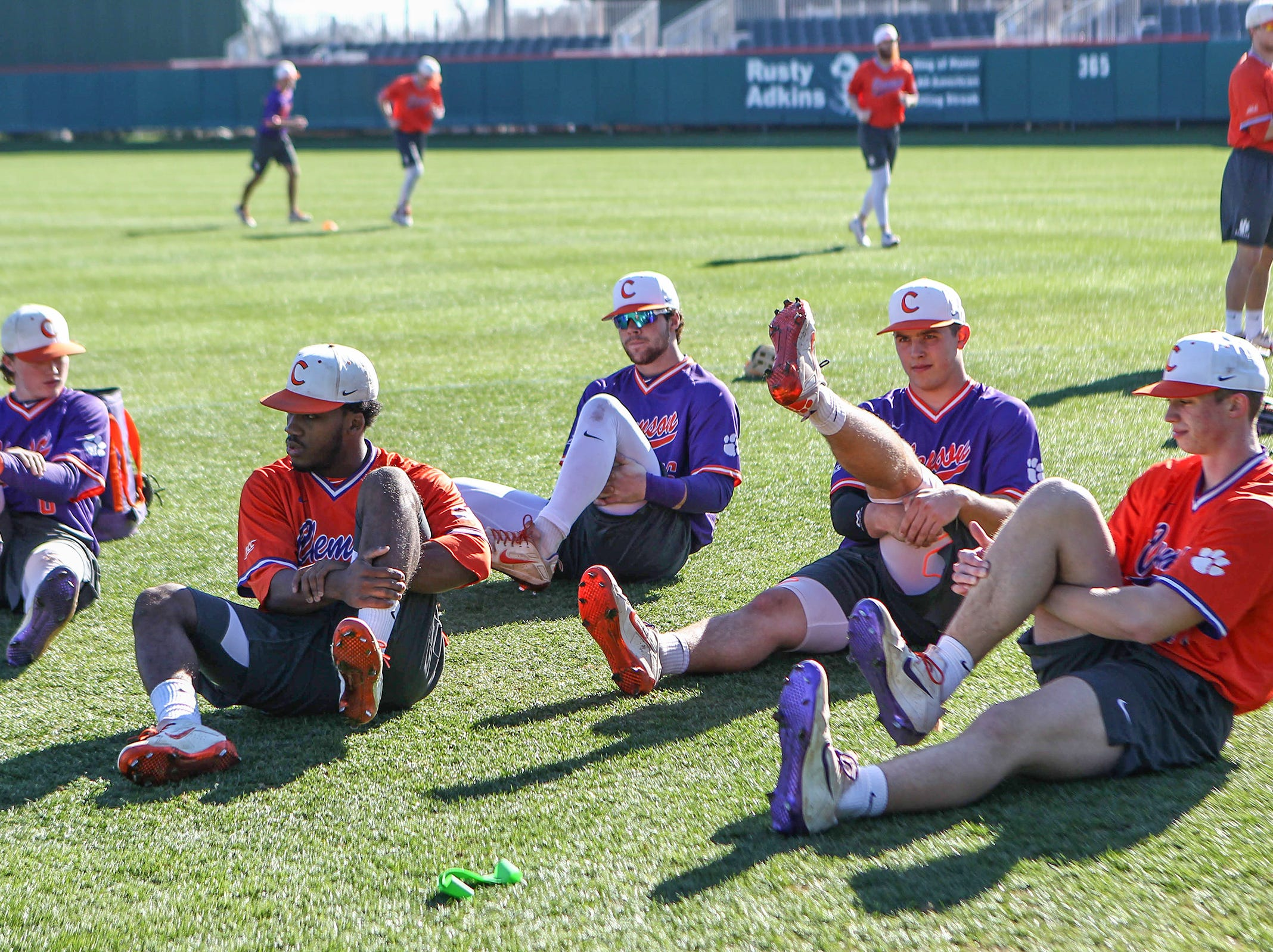 Clemson players stretch during practice at Doug Kingsmore Stadium in Clemson Friday.