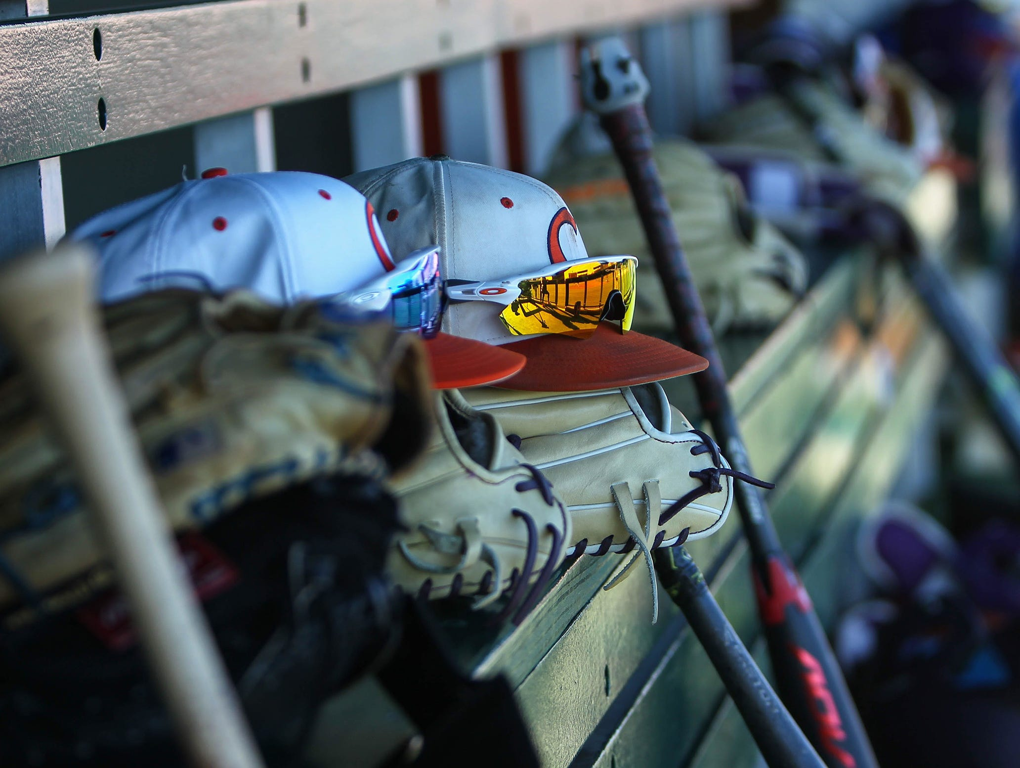 Clemson hats and gloves line the dugout before practice at Doug Kingsmore Stadium in Clemson Friday.