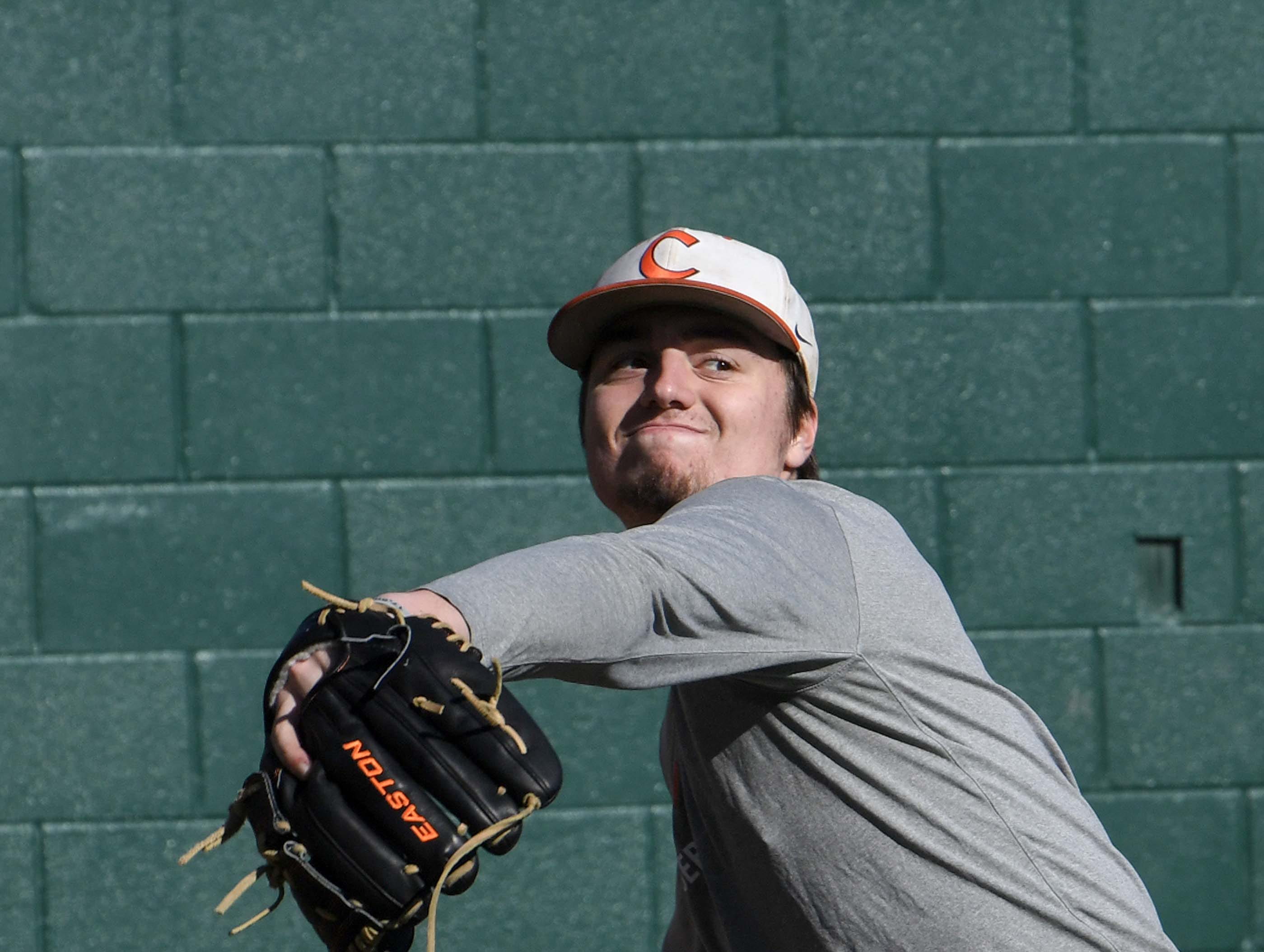 Clemson freshman pitcher Jackson Linley warms up during practice at Doug Kingsmore Stadium in Clemson Friday.