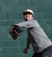 Clemson freshman pitcher Jackson Linley warms up during practice at Doug Kingsmore Stadium in Clemson Friday.