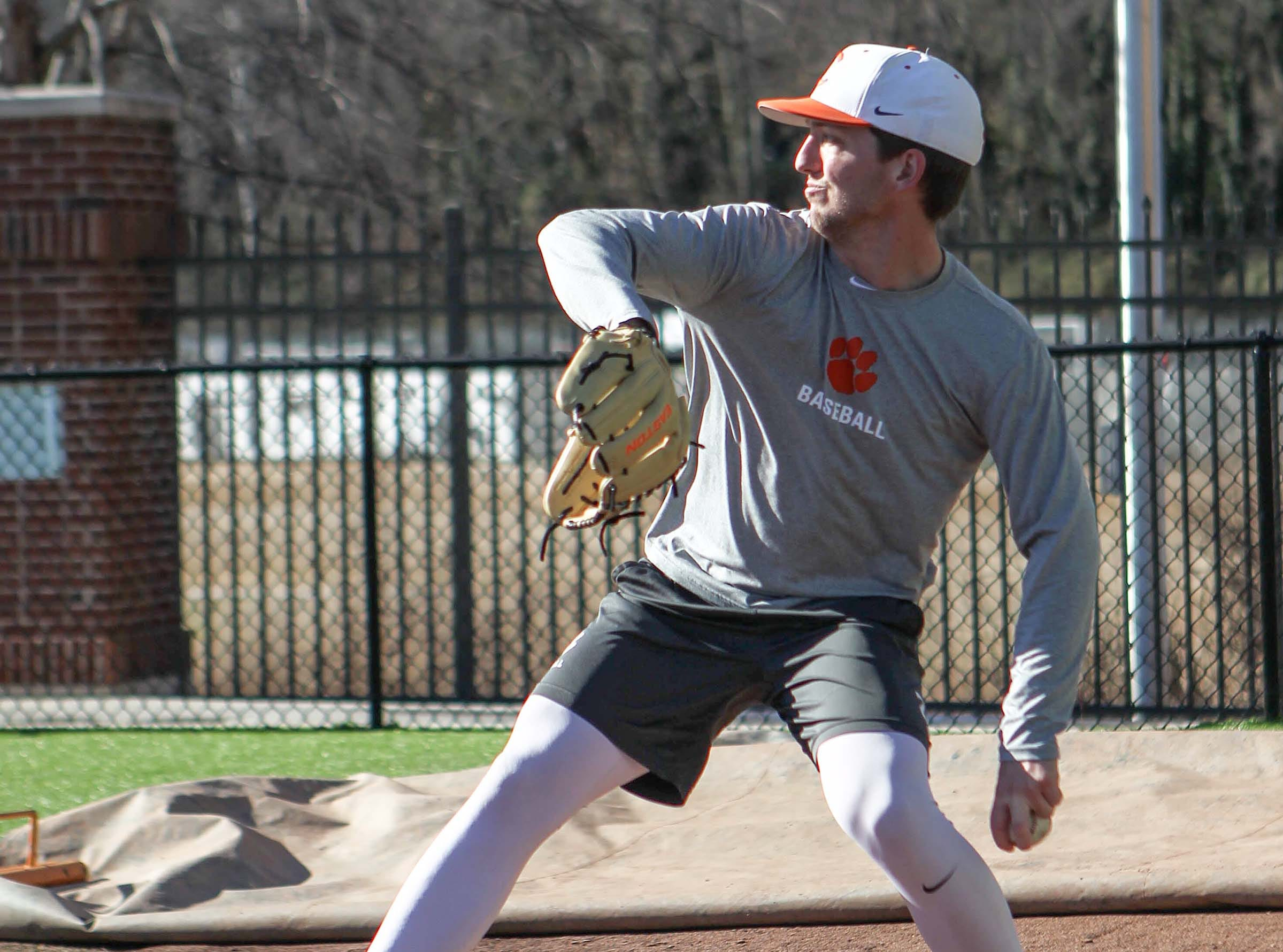 Clemson pitcher Jackson Linley warms up during practice at Doug Kingsmore Stadium in Clemson Friday.