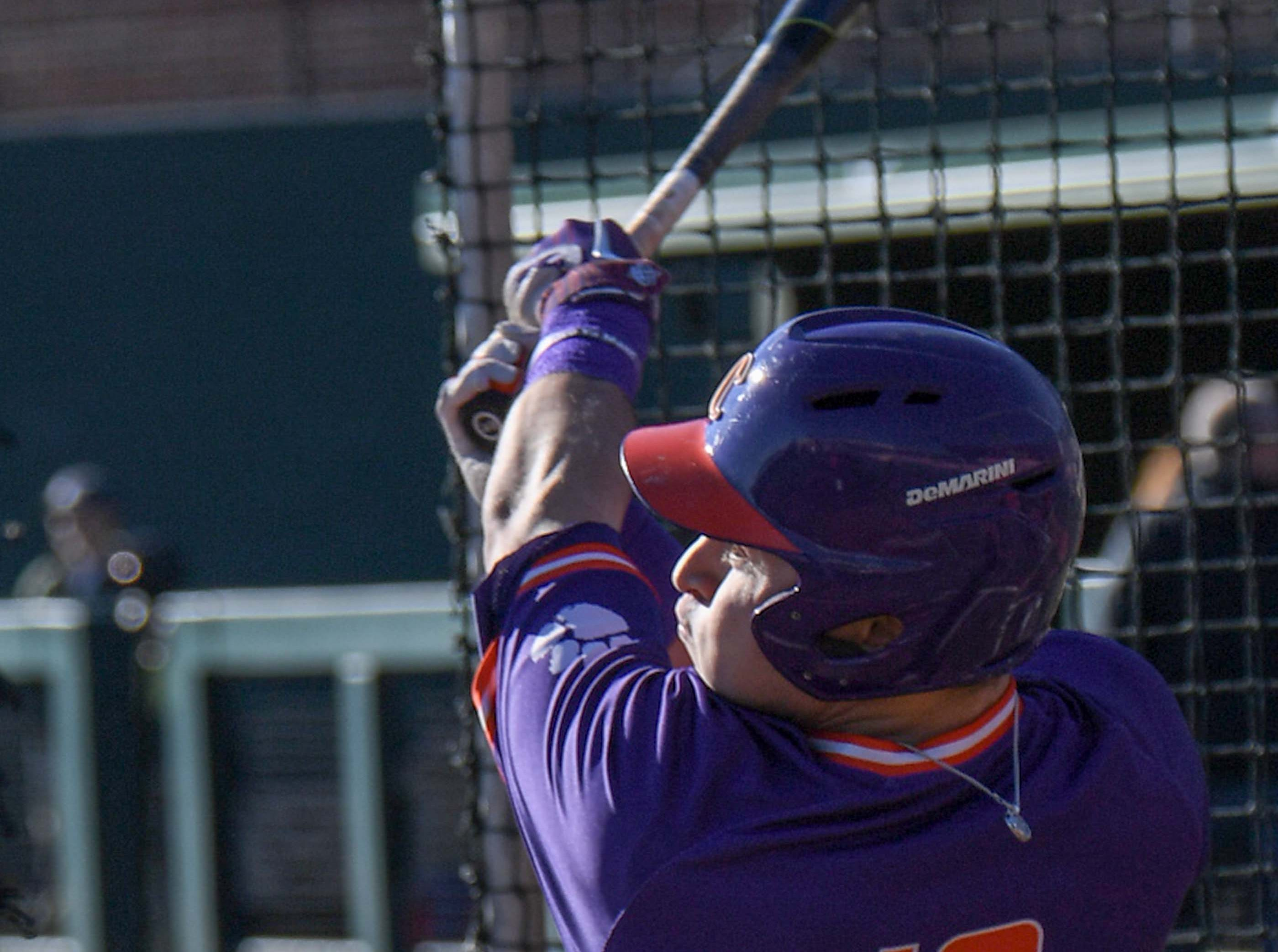 Clemson outfielder Bo Majowski (16) hits a pitch during practice at Doug Kingsmore Stadium in Clemson Friday.