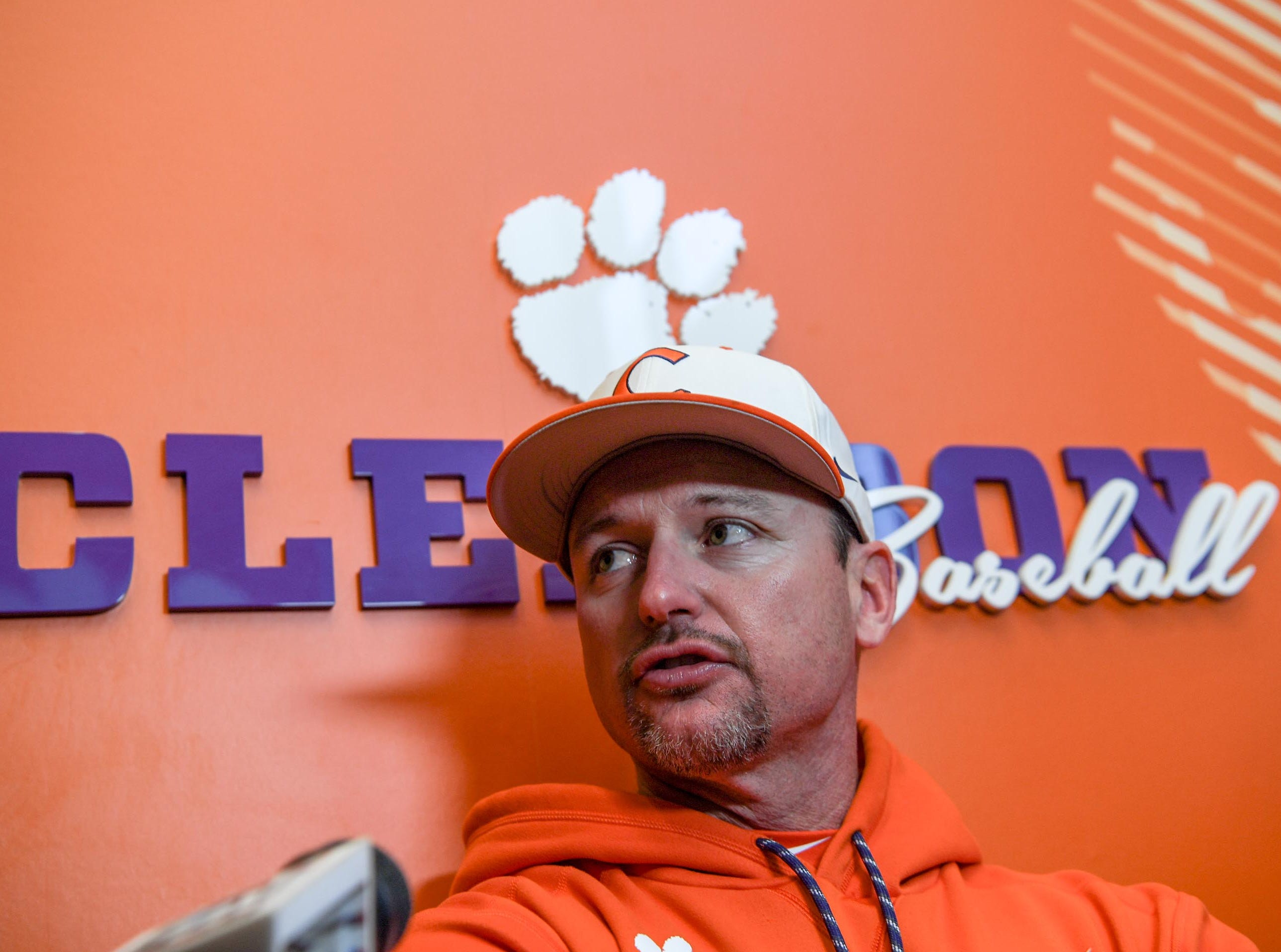 Clemson coach Monte Lee talks with media before practice at Doug Kingsmore Stadium in Clemson Friday.
