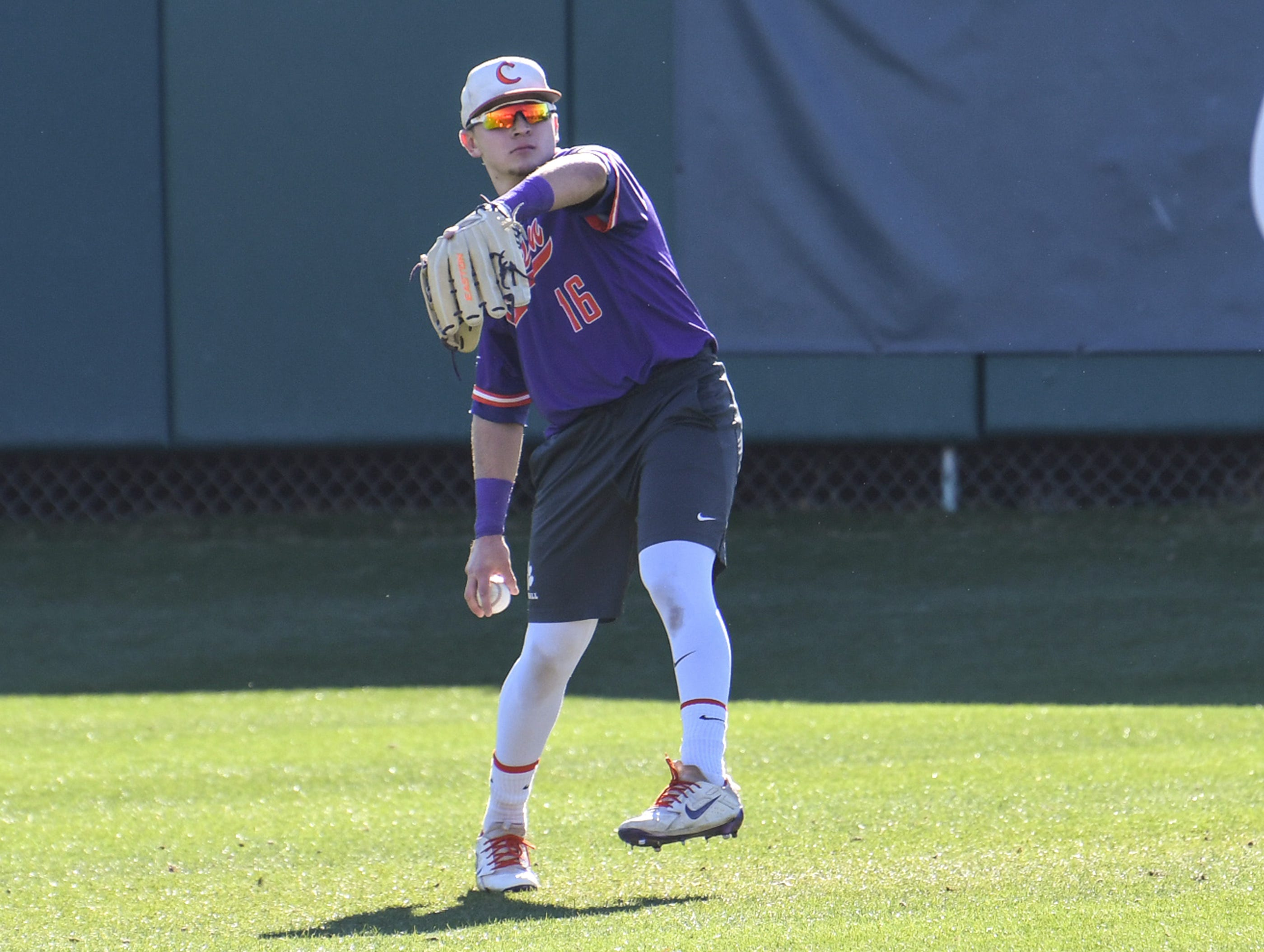 Clemson outfielder Bo Majkowski (16) warms up with teammates during practice at Doug Kingsmore Stadium in Clemson Friday.