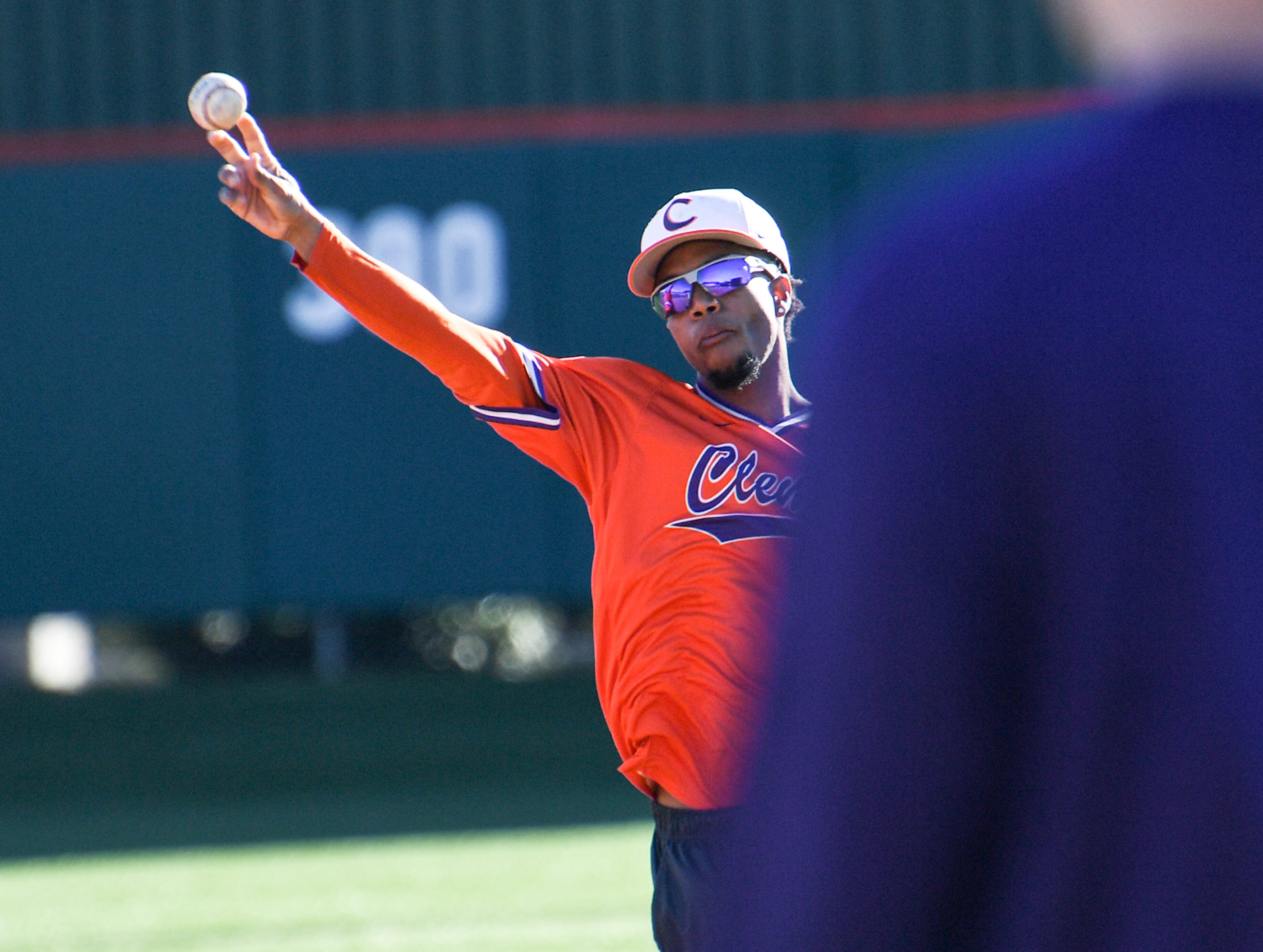 Clemson second baseman Jordan Greene fields a ball to first base during practice at Doug Kingsmore Stadium in Clemson Friday.