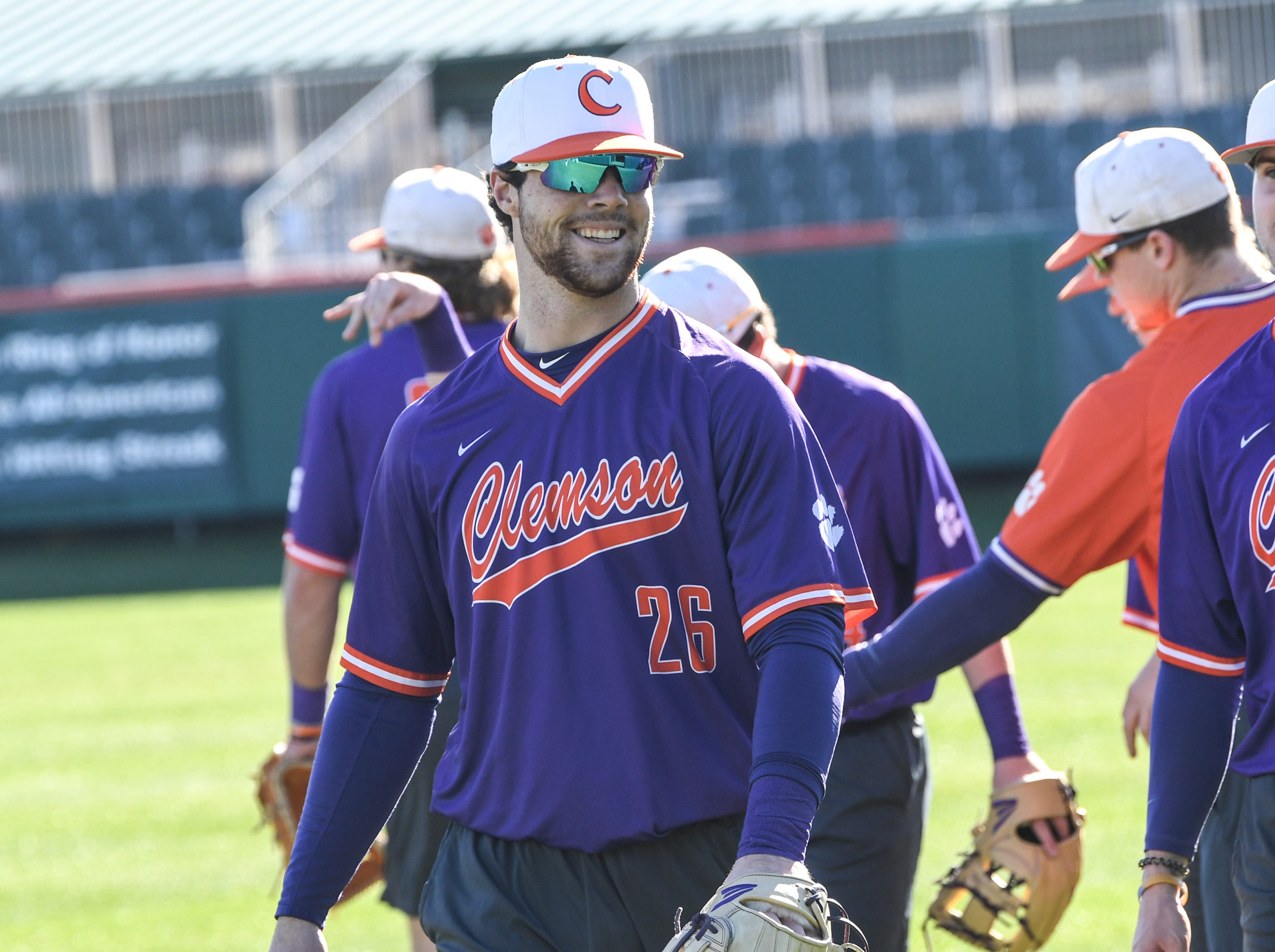 Clemson catcher Matt Cooper (26) warms up together during practice at Doug Kingsmore Stadium in Clemson Friday.