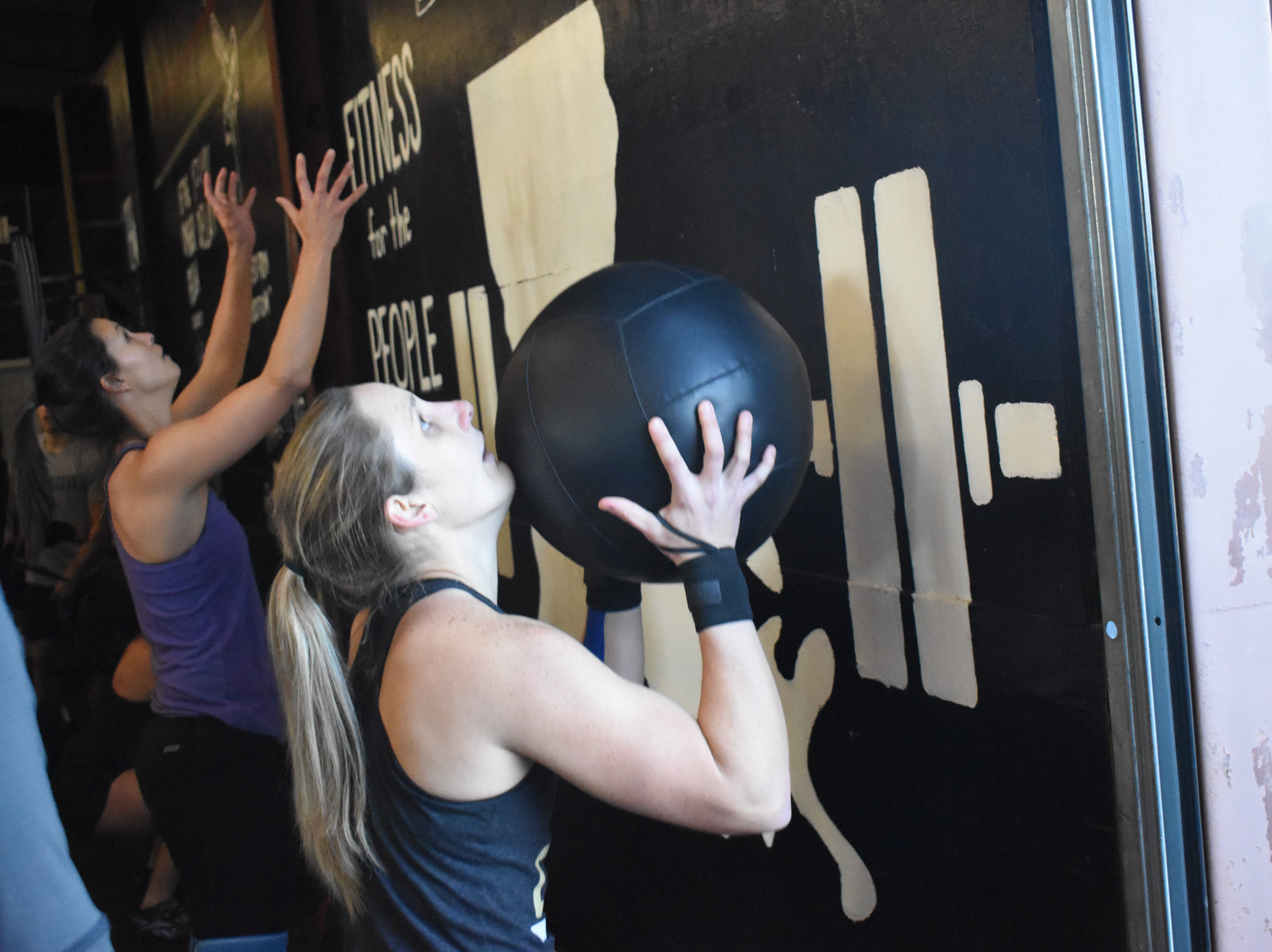 Rachel Daniels of CrossFit 28 in Pineville performs a set of wall balls in the Iron Boot Classic. Twenty teams from six CrossFit affiliates in the area competed in the Iron Boot Classic  Saturday, Jan. 26, 2019 at the Iron Boot, formerly CrossFit Alexandria. Each team consisted of two men and two women who competed in five heats throuighout the day. Some of the exercises they performed were classic workouts such as deadlifts, burppees, wall balls and thrusters. William Albritton, owner of Iron Boot, said the competition involved the classic movements so everyone who works out could participate.