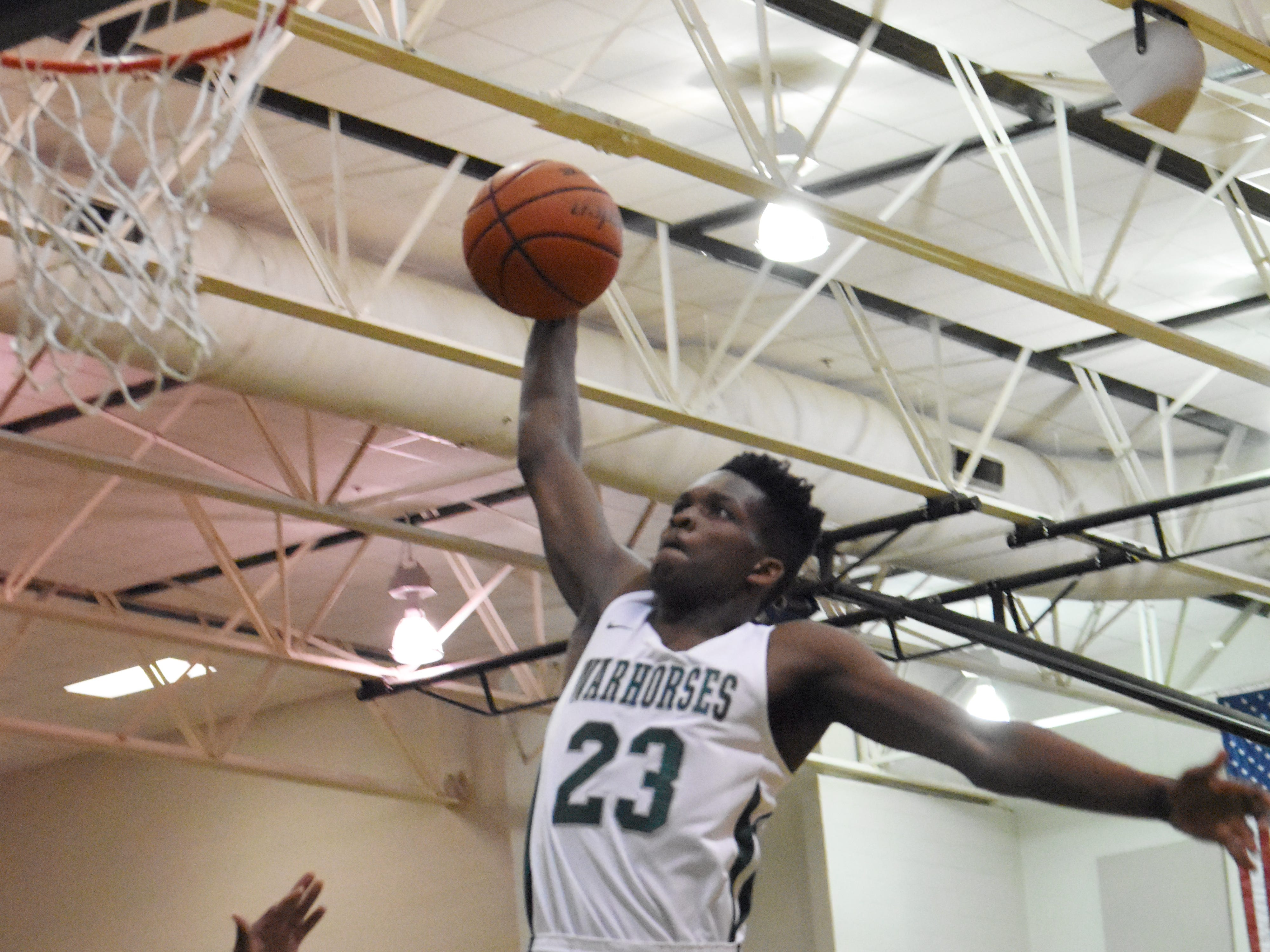 Peabody senior Darius Smith (23) skies for a dunk against Bolton High School at the Emerald Palace Friday, Jan. 25, 2019. Smith was named as the District 3-3A MVP.
