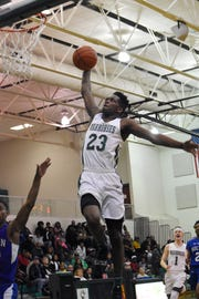 Peabody senior Darius Smith (23) skies for a dunk against Bolton High School at the Emerald Palace Friday, Jan. 25, 2019. The Warhorses are looking for their fourth straight trip to the state tournament.
