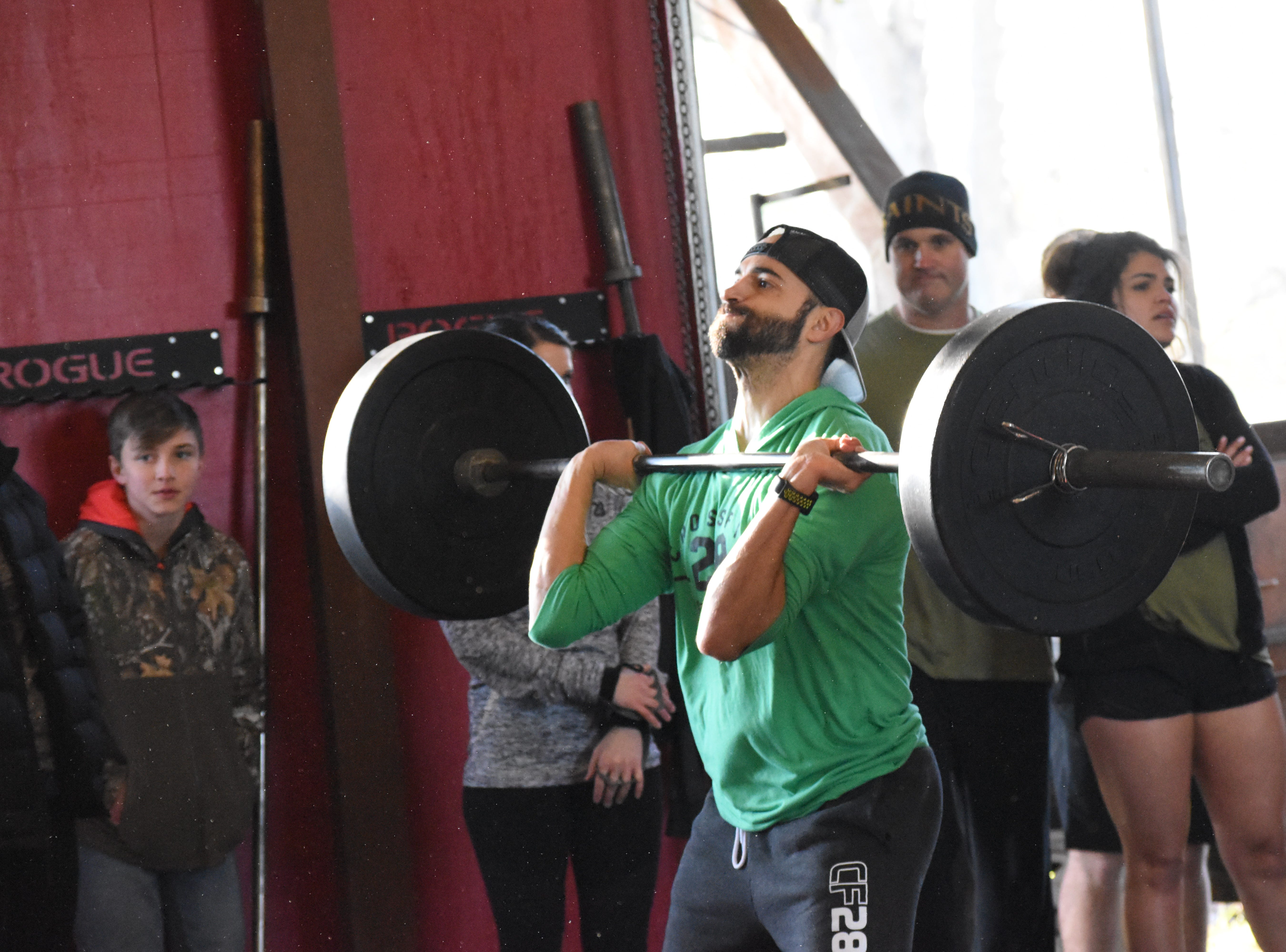 Twenty teams from six CrossFit affiliates in the area competed in the Iron Boot Classic  Saturday, Jan. 26, 2019 at the Iron Boot, formerly CrossFit Alexandria. Each team consisted of two men and two women who competed in five heats throuighout the day. Some of the exercises they performed were classic workouts such as deadlifts, burppees, wall balls and thrusters. William Albritton, owner of Iron Boot, said the competition involved the classic movements so everyone who works out could participate.
