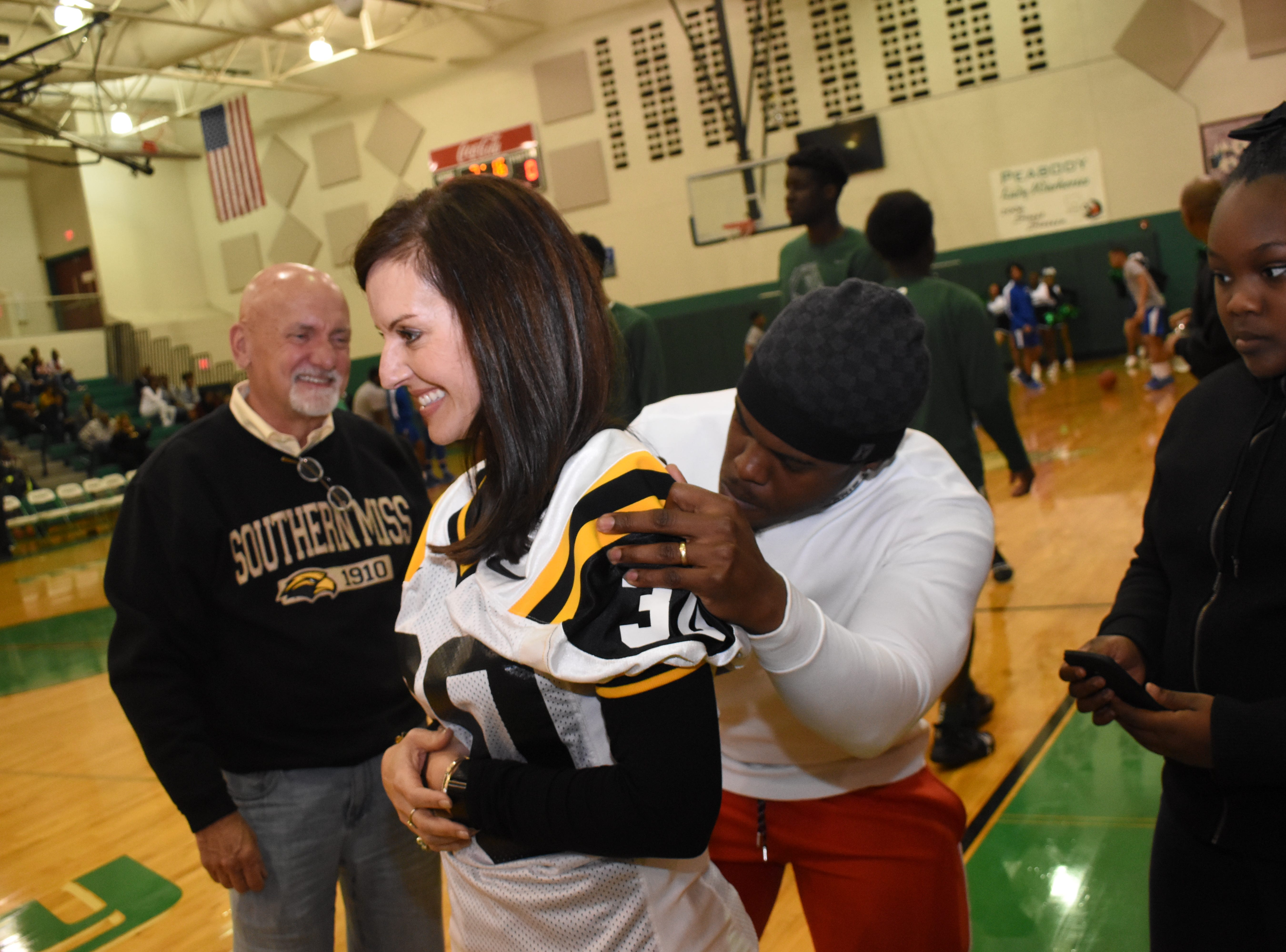 Oakland Raiders running back Jalen Richard (right) signs a University of Southern Mississippi jersey for Tami Blackwell. Her husband Duane Blackwell and Richard are graduates of Southern Miss. Richard graduated from Southern Miss in 2016. The Blackwells were among those attending a ceremony at Peabody Magnet High School where Richard's jersey was retired. Richard graduated from Peabody in 2012. While at Peabody, Richard made the LSWA Class 4A All-State first team as a junior, and the All-Cenla and All-District first teams as a sophomore and a junior. Richard signed a contract with the Raiders in 2016 after being invited to attend a rookie minicamp.