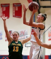 Appleton East's Emily La Chapell, right, is one of the top freshman in the state.