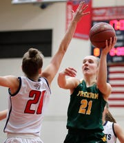 Freedom sophomore Callie Genke drives to the basket against Appleton East freshman Emily La Chapell during a game earlier this season.