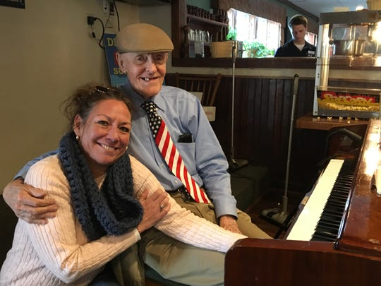 "Fan Jennifer Bradshaw poses with Frank ""Frankie Fingers"" Staknys  at the Crab's Claw Inn in Lavallette."