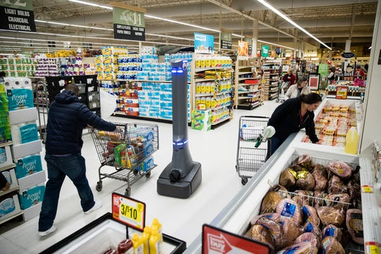 A robot named Marty cleans the floors at a Giant grocery store in Harrisburg, Pa., in January 2019 Robots aren't replacing everyone, but a quarter of U.S. jobs will be severely disrupted as artificial intelligence accelerates the automation of today's work, according to a new Brookings Institution report.
