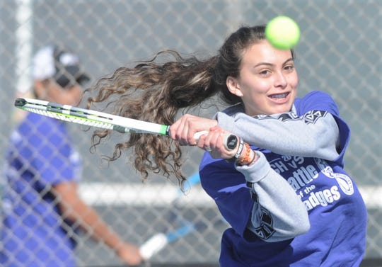 Abilene High's Cassie Hernandez watches her return shot during the second annual Police-Fireman Tennis Match on Saturday, Jan. 26, 2019, at Rose Park Tennis Center. The event, put on by the AHS and Cooper tennis programs, raised money to fight colon cancer. Hernandez teamed up with police officer Zack Hall to play against Cooper's Beau Hollowell and firefighter Taylor Smith.