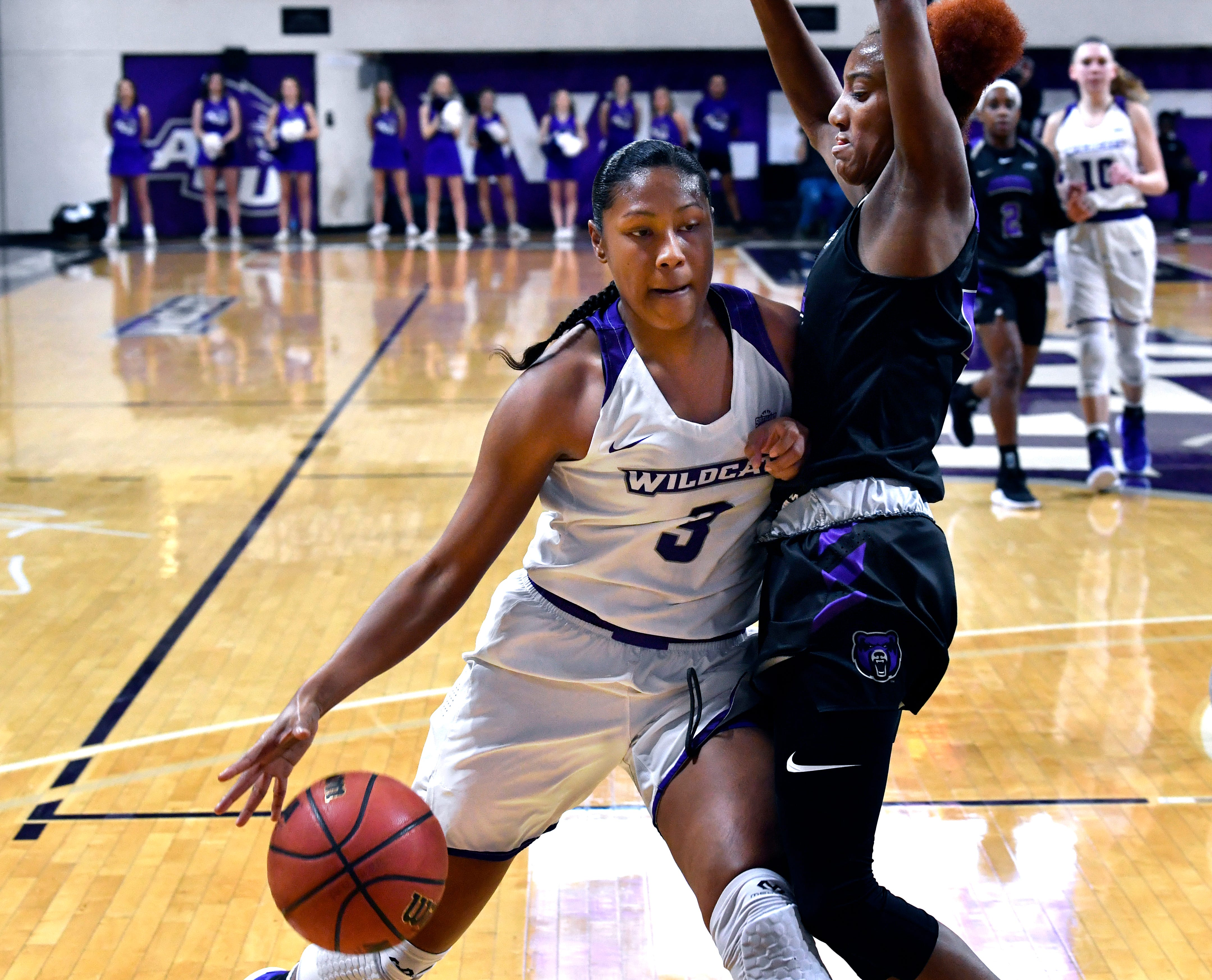 Lady Wildcats Dominique Golightly elbows into Central Arkansas' Taylor Sells during Saturday's women's basketball game at Abilene Christian University. Final score was 77-70, ACU.