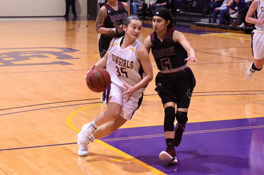HSU's Maria Fernandez (35) drives past McMurry's Dominique Machuca (5) at the Mabee Complex on Saturday, Jan. 26, 2019.