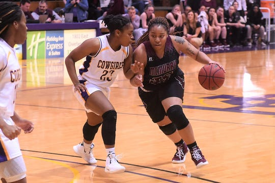 McMurry's Brittany Rodgers (35) drives against HSU's Jesyka Lee (23) at the Mabee Complex on Saturday, Jan. 26, 2019.