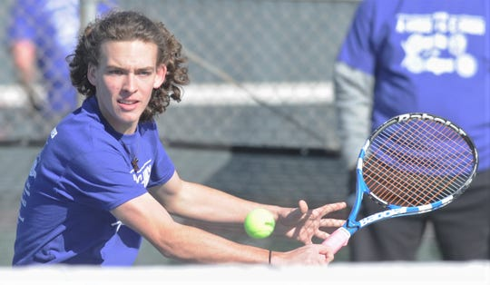 Abilene High's Clark Sullivan hits a shot during the second annual Police-Fireman Tennis Match. Now Sullivan and partner Kaitlyn Strain are heading to the Region I-6A tournament starting Wednesday in Arlington as District 3-6A champions.