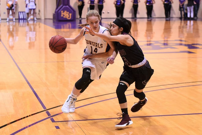 HSU's Karlea Ritchie (14) tries to drive past McMurry's Dominique Machuca (5) at the Mabee Complex on Saturday, Jan. 26, 2019.