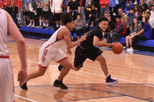 Wylie's Shayden Payne (22) tries to drive past Cooper's Noah Garcia (3) at Cougar Gym on Friday, Jan. 25, 2019. The Bulldogs won 58-47.