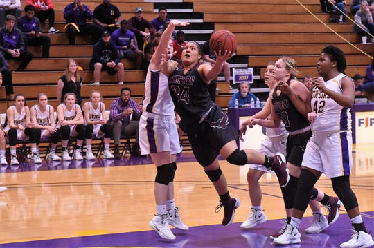 McMurry's Skyler Reyna (34) goes under an HSU defender for a basket at the Mabee Complex on Saturday, Jan. 26, 2019.