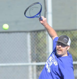 Jason Aulerich, a campus officer at Abilene High, watches his return shot in the second annual Police-Fireman Tennis Match put on by the Abilene High and Cooper tennis teams on Saturday, Jan. 26, 2019, at Rose Park Tennis Center. Aulerich teamed up with AHS' Clark Sullivan to play firefighter Seth Westin and Cooper's Jake Aldridge.