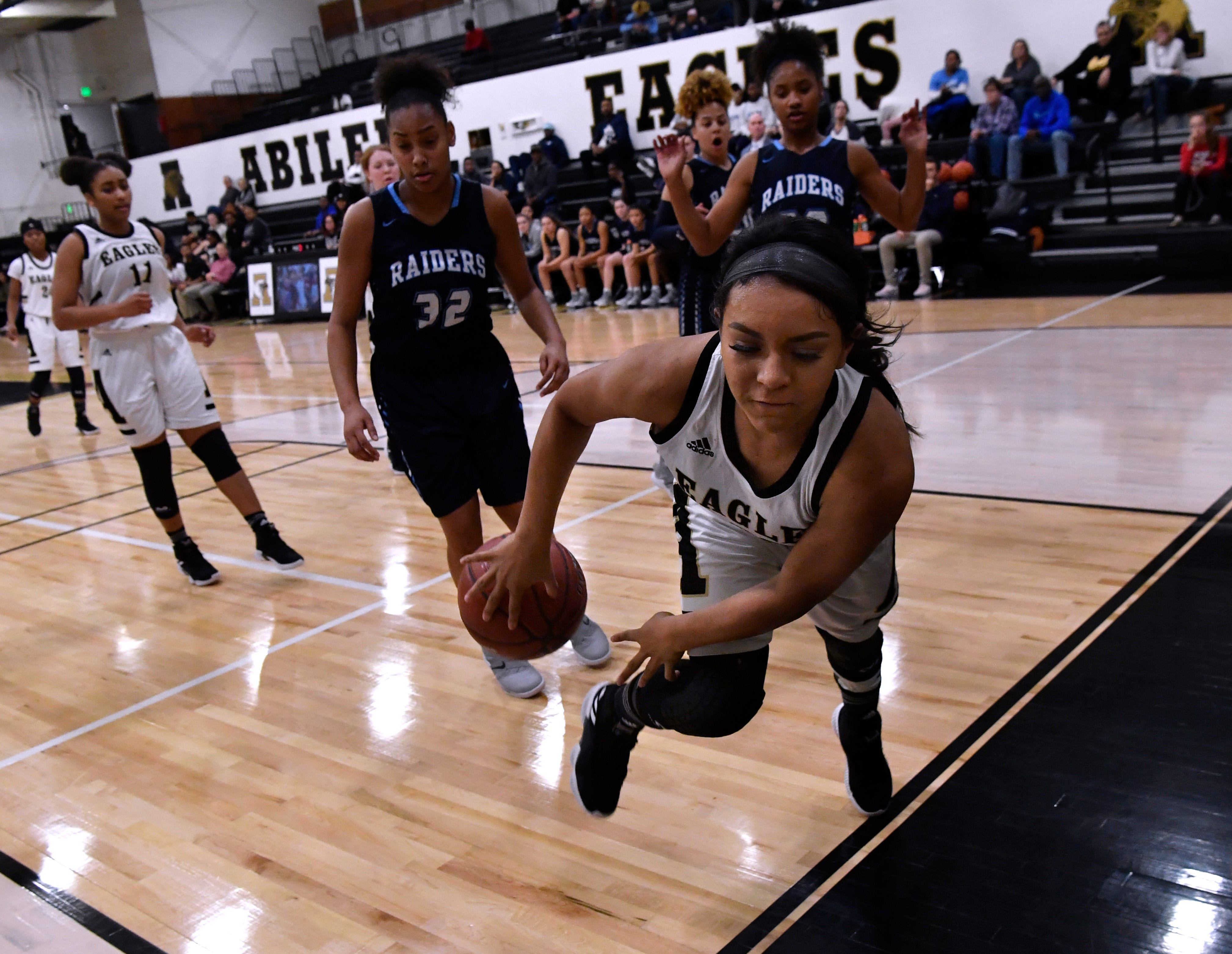 Abilene High's Georgia Montes dives out of bounds while trying to save the ball during Friday's game against Hurst Bell in the Eagle Gym Jan. 25, 2019. Final score was 58-51, Hurst Bell.