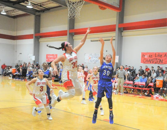 Stamford freshman post Citlaly Gutierrez, right, scores in the paint as Albany's Elia Hebel flies in to defend.