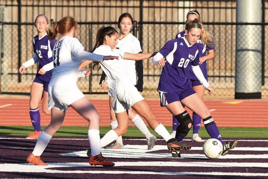 Wylie's Jacqueline Williams (20) tries to make a play in the box early in the season. Williams will trade in purple for green after signing with NCAA Division II Missouri Southern State on Saturday.