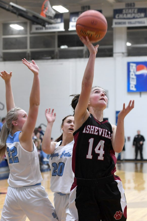 Asheville's Emma Smith goes up for a shot against Enka during their game at Enka High School on Jan. 25, 2019. The Lady Cougars defeated the Sugar Jets 56-52.