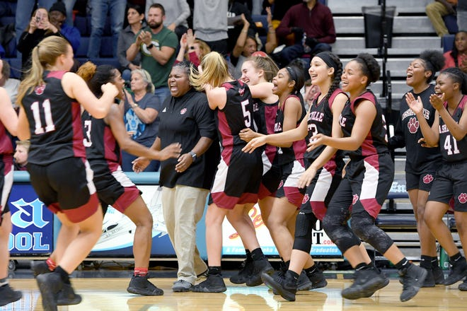 Asheville coach Sonita Warren-Dixon and the Lady Cougars celebrate their during their 56-52 win over Enka at Enka High School on Jan. 25, 2019.