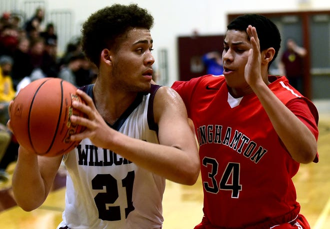 Johnson City's Xavier Hill, 21, looks to move past Binghamton's Yordanel Padres-Cintron, 34, during a game on January 25, 2019. Hill averaged 21.4 points, 8.6 rebounds and 2.2 assists per game last season and was selected to the Elite 10 team.