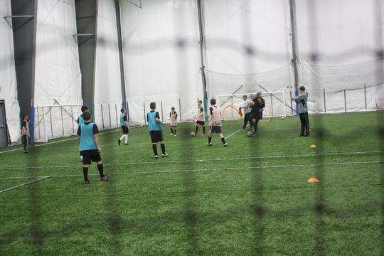Teams practice inside the 434 SportsPlex.