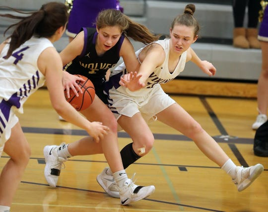 North Kitsap's Noelani Barreith (left) and Raelee Moore (right) put the pressure on Sequim's Jessica Dietzman in Poulsbo on Friday, January 25, 2019.