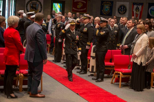 Rear Adm. Douglas Perry, the new commander of Submarine Group 9, enters the Bangor Chapel Friday. (U.S. Navy photo by Mass Communication Specialist 1st Class Amanda R. Gray/Released)