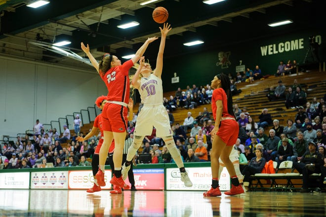 Vermont's Hannah Crymble (10) shoots the ball over Stony Brook's McKenzie Bushee (22) during the women's basketball game between the Stony Brook Seawolves and the Vermont Catamounts at Patrick Gym on Saturday afternoon January 26, 2019 in Burlington, Vermont.