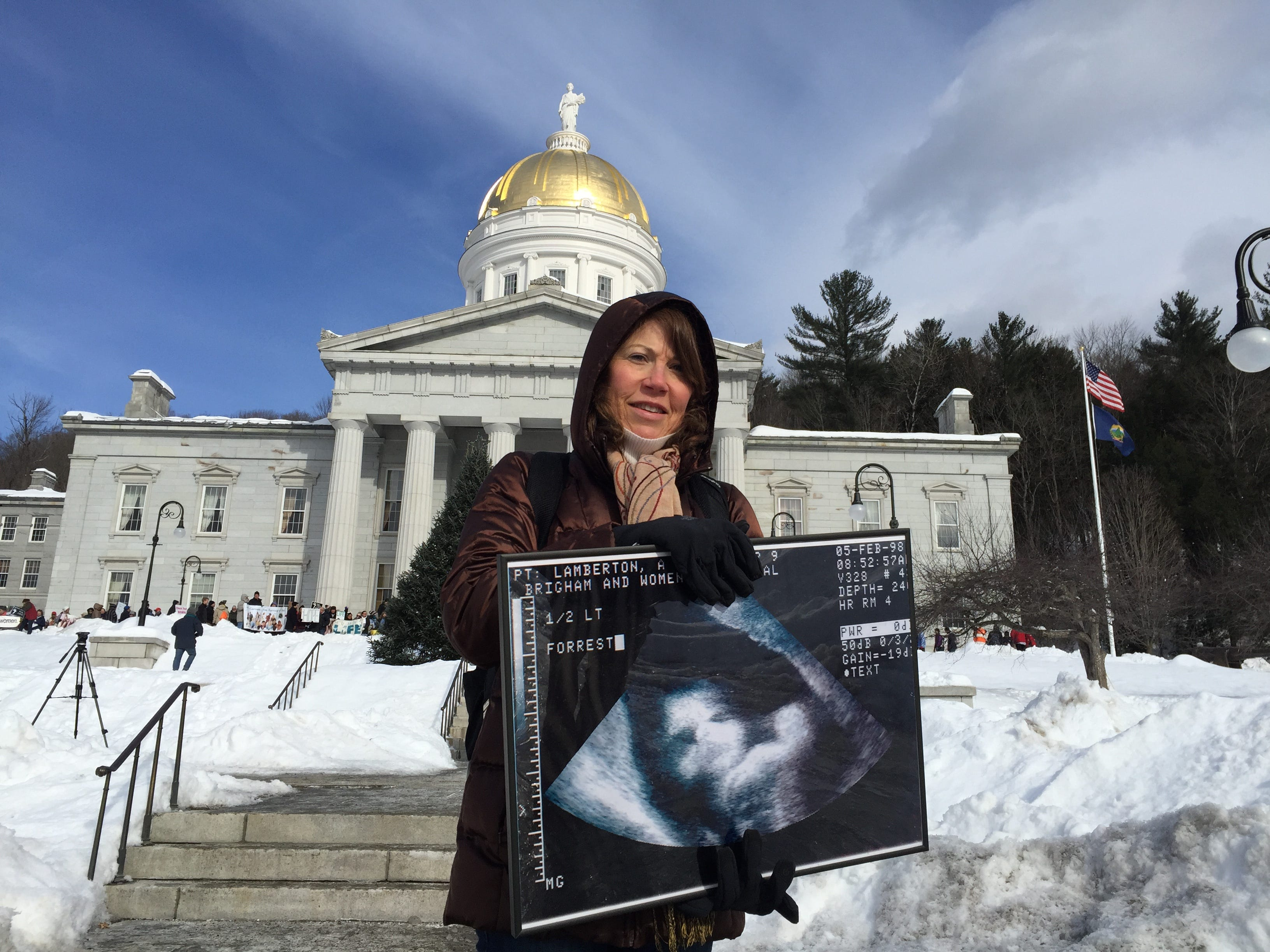 """Annisa Lamberson of Middle Springs carried an ultrasound image of her son, who died six hours after birth.  """"I'm here because of love not hate,"""" Lamberson said on Jan. 26, 2019 at an anti-abortion rally."""
